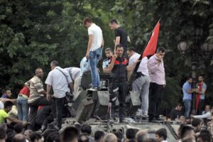 A Turkish policeman and other people stand atop of a military vehicle in Ankara, Turkey July 16, 2016. REUTERS/Stringer   EDITORIAL USE ONLY. NO RESALES. NO ARCHIVES.